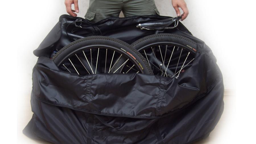 зачехлите велосипед с двумя снятыми колесами